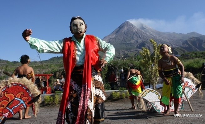 Merapi Volcano at the background, with traditional Javanese rituals being performed.
